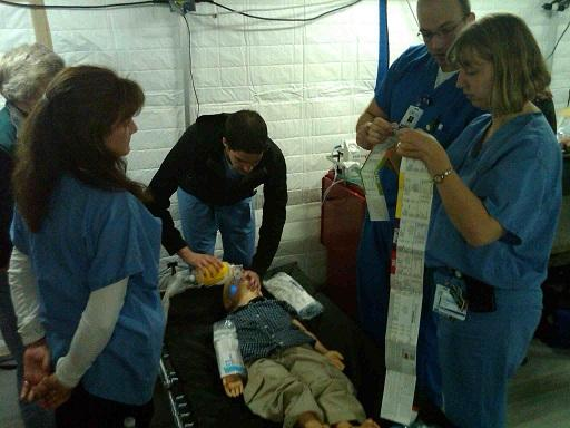 Doctors and nurses train in the pediatric unit of a 140 bed mobile hospital near Dimondale, Michigan