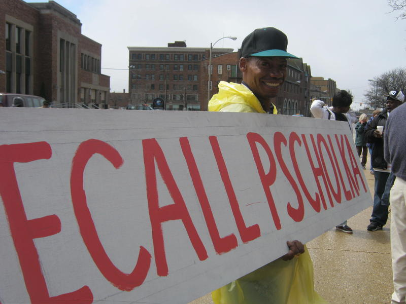 "Calls to ""recall Pscholka"" have been made for several weeks. This protestor carries a sign during a protest against Benton Harbor's emergency manager on April 27th, 2011. Pscholka introduced the bill that grants emergency managers broader powers."