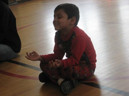A little meditation helps the students get on an even keel before starting games like four square and wall ball.