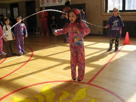 There are several activites going on at once during the recess periods Playworks oversees, including jump rope - which seems to be a favorite among the girls at Bennett Elementary.