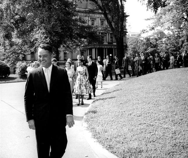 Sargent Shriver leading Peace Corps trainees to the White House to meet with President Kennedy.