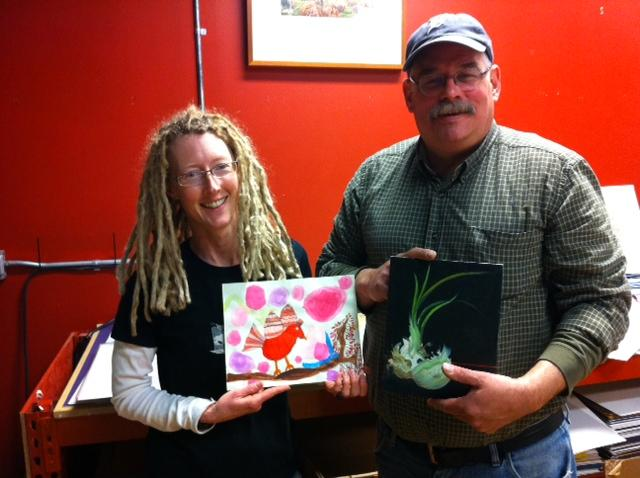Valerie Mann & Peter Bowe holding small art for sale
