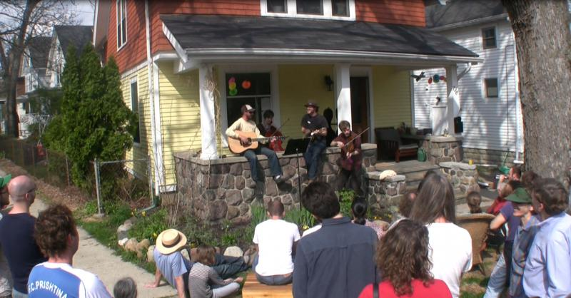Neighbors play music from their front porch during the Water Hill Music Festival in Ann Arbor, Michigan. There were 60 performances around the neighborhood.
