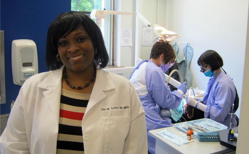 Primary Care Doctor Lisa Lowery shows off the health clinic's laboratory, patient rooms, and the dental clinic (behind her).