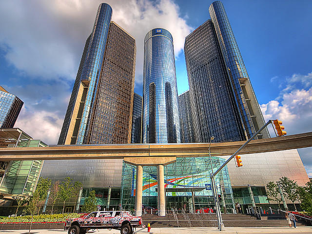 "General Motors' headquarters in downtown Detroit. GM's North American president, Mark Reuss says the company ""is dedicated to helping rebuild this city."""