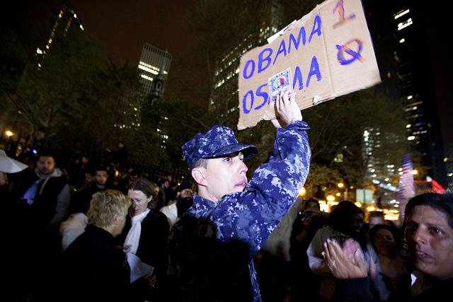 Crowds cheering at Ground Zero in New York City after hearing the news of Osama bin Laden's death.