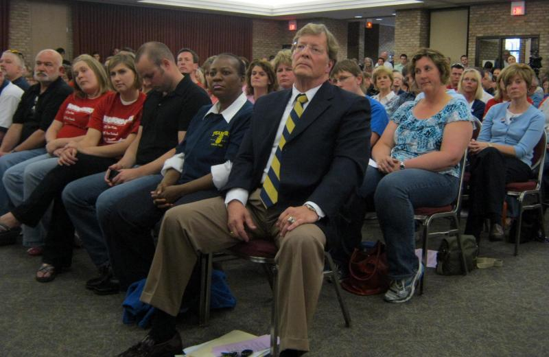 "Rockford Public Schools Superintendent Mike Shibler sits in the front row. He says the school aid fund is for K-12 education. ""I know exactly what Proposal A was about because I was here, I was involved in the campaign supporting it."""