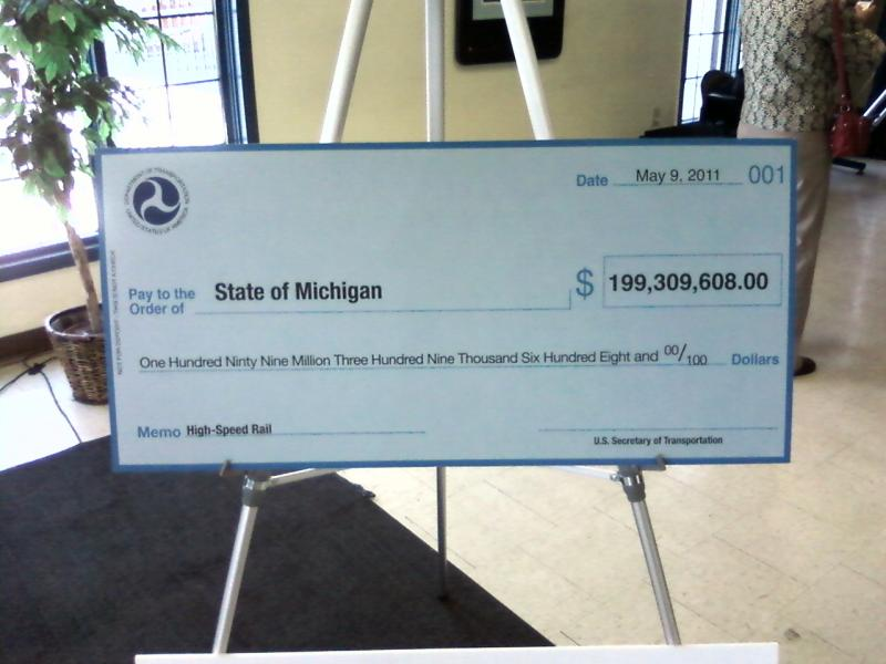 U.S. Transportation Secretary Ray LaHood presented a novelty check at Detroit's Amtrak station.