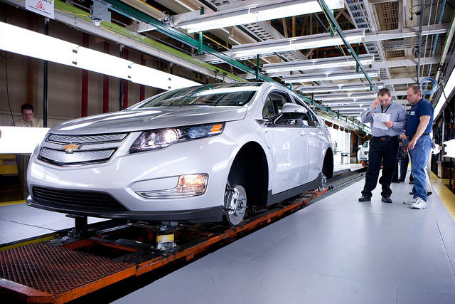 An economist says the resurging domestic auto industry is helping the state get back on its feet (assembly of the Chevy Volt).