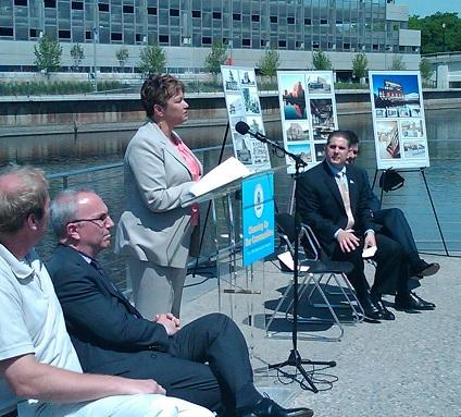 EPA Administrator Lisa Jackson announcing brownfield cleanup grants during a news conference in Lansing, Michigan.   To the right of the speaker, Lansing Mayor Virg Bernero looks on.