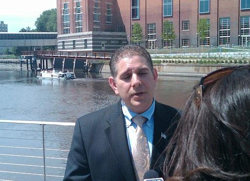 Lansing mayor Virg Bernero talks to reporters along the Grand River