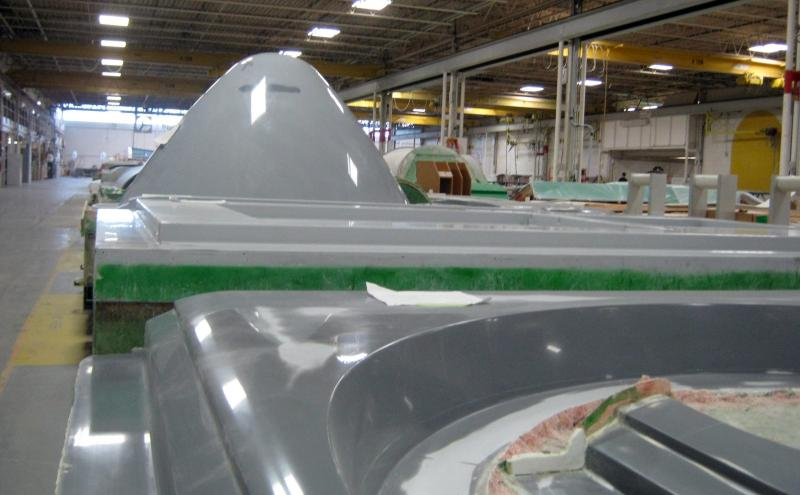 A cone for the front of a large scale wind turbine uses some of the same material and processes used for constructing boats.
