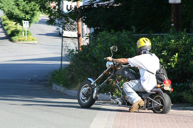 A moped chopper. Helmet needed?