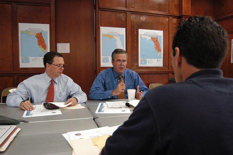 Former Governor Jeb Bush (center) is in Michigan today to discuss education reforms.