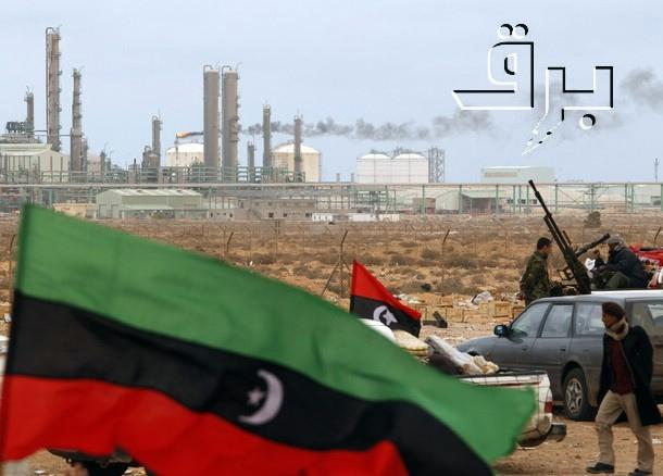The Kingdom of Libya flag placed in front of a refinery in Ras Lanuf March 8, 2011. The flag has been used as a symbol of resistance against Libya's leader Muammar Gaddafi.