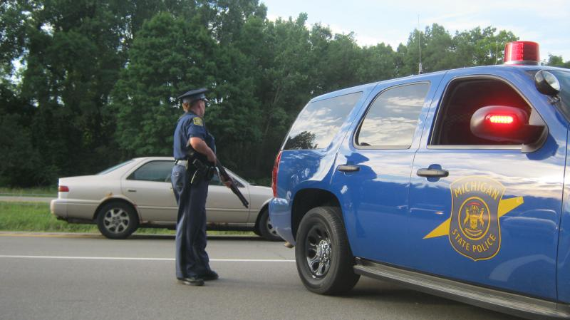Armed police stand guard after closing I-96 in Grand Rapids following a chase through downtown.