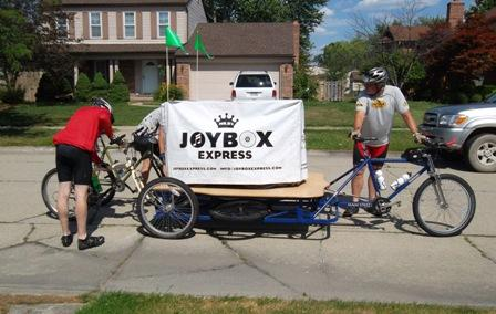 Marc Braun (right), Brian Delaney and Pete Siers pedal the 352-pound piano across Michigan.