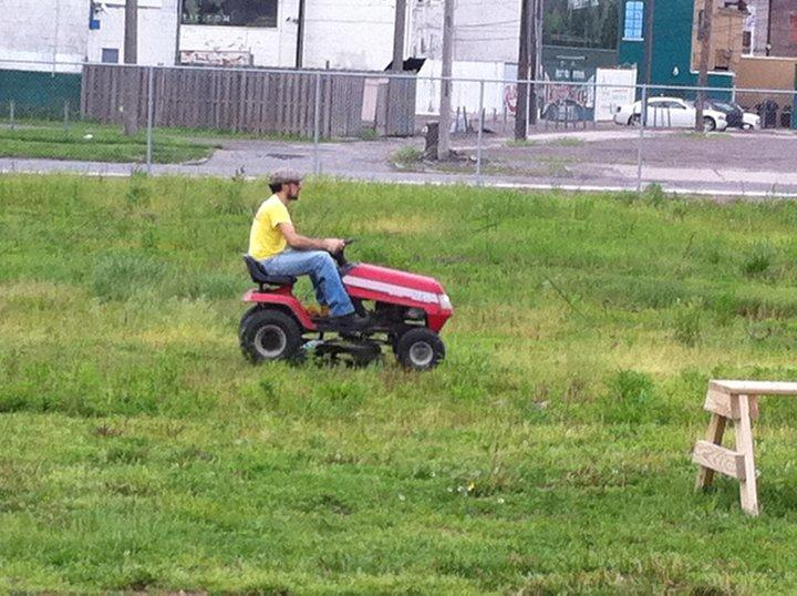 Dave Mesrey cuts the grass at Michigan and Trumbull.