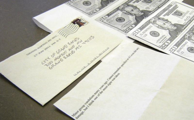 The letter and copies of the five $20 bills mailed to the City of Grand Rapids this week.