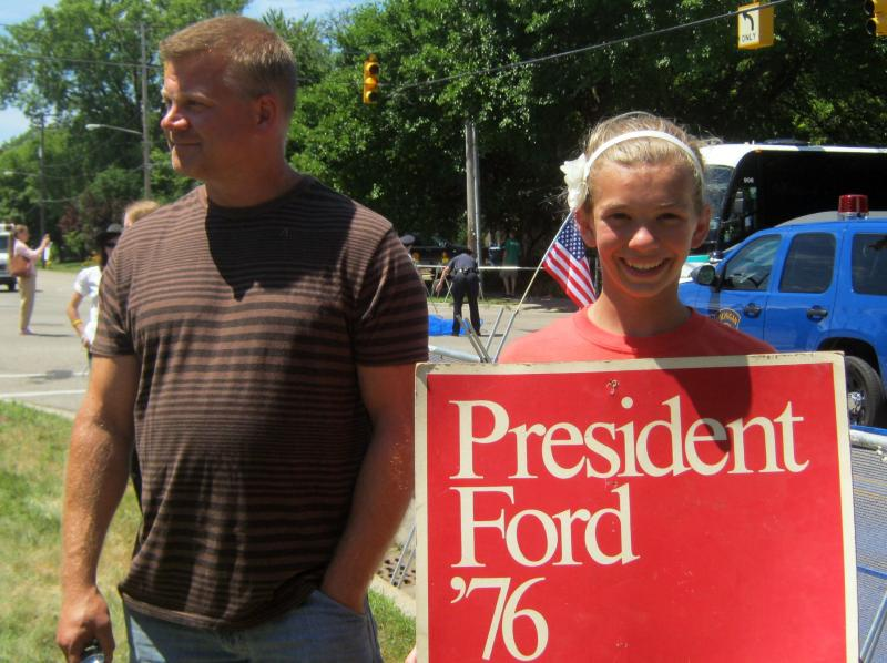 Jim and Anny Rauwerda show off the Ford yard sign they unearthed in the basement. The cardboard sign is in pretty good shape for it's age.