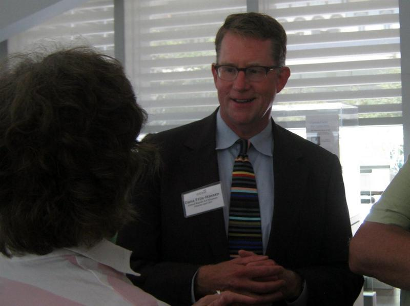 Dana Friis-Hansen meets with community members at a reception for him Friday afternoon.