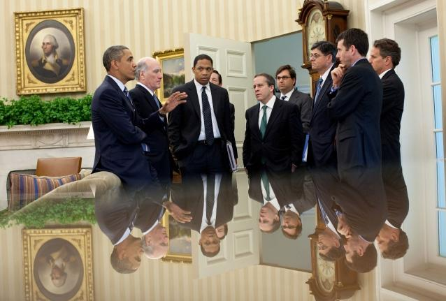 President Barack Obama talks with members of his staff in the Oval Office following a meeting with the Congressional Leadership, July 7, 2011.