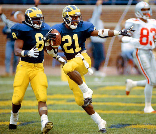 Desmond Howard strikes the Heisman pose after he returned a punt for a touchdown against Ohio State in 1991.
