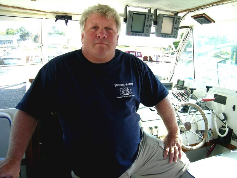 C. J. Baker operates a salmon fishing charter boat for Puddle Jumpers Charters.  He moved his boat from Lake Huron to Lake Michigan after the salmon fishing collapsed in Lake Huron.