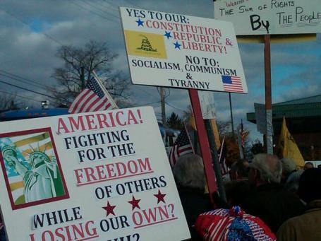 Sign wielding protesters at a Tea Party Express rally in Jackson, Michigan in 2010