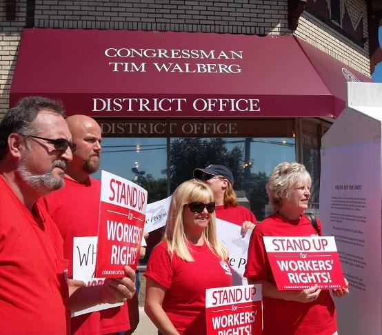Members of the American Federation of Goverment Employees, Communications Workers of America and other groups picket outside Michigan Republican Congressman Tim Walberg's office in Jackson