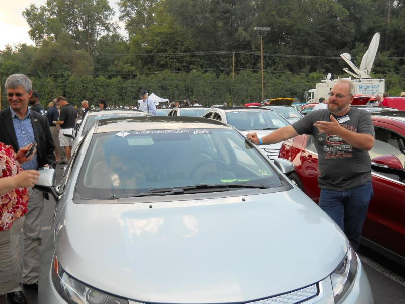A Volt owner shows off his new car prior to the parade.