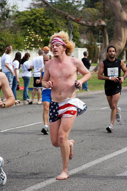 Man runs barefoot in the Los Angeles Marathon.