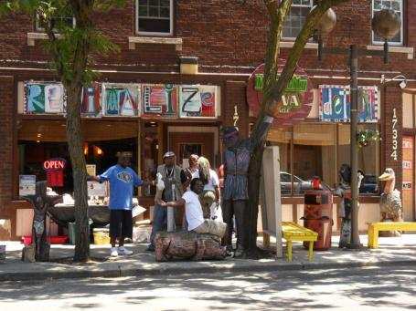 A group of people gather outside Chazz Miller's art studio in Old Redford, a neighborhood in Detroit