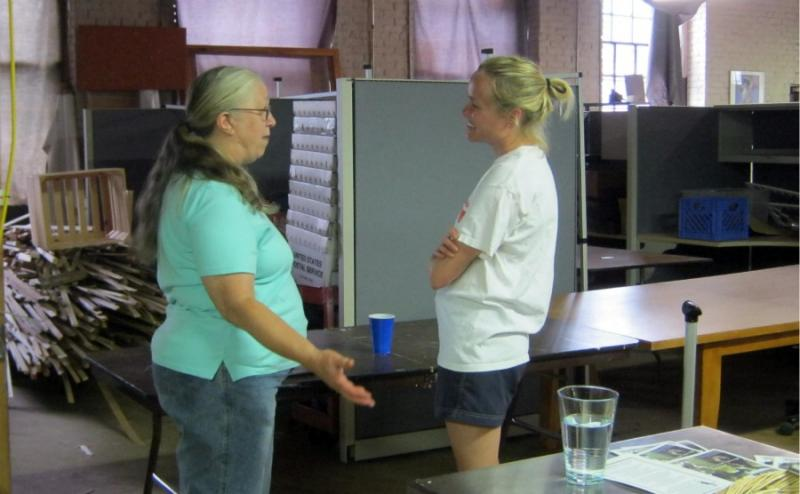 Barbara Jenness (left) and Amy Sherman (right) chat during the meet-up. Part of FarmLink's goal to create communities of people interested in promoting locally grown food.
