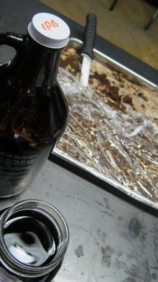 The group shares locally-brewed beer and homemade baked goods before swapping plastic bins full of local produce.