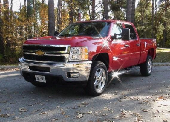 GM says it will cut production of pickup trucks next month. The 2011 Chevy Silverado, GM's best-selling truck.