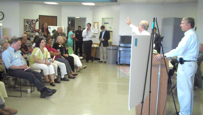 A woman at the community forum in Kalamazoo with Congressman Fred Upton demands that he talk about jobs.
