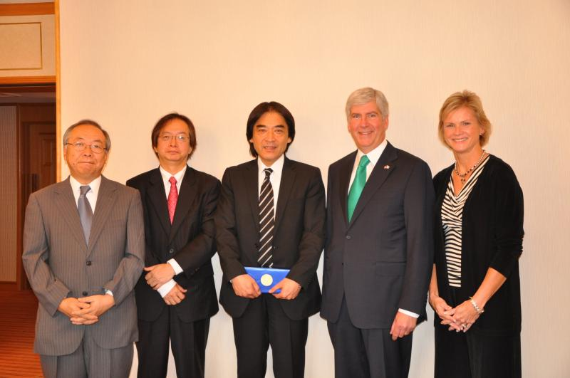 Gov. Rick Snyder meets with Takamichi Matsushita, president of Eco Research Institute of Tokyo (center). Pictured with Snyder is Carol Miller, right, of Midland Tomorrow, and ERI leadership officials.