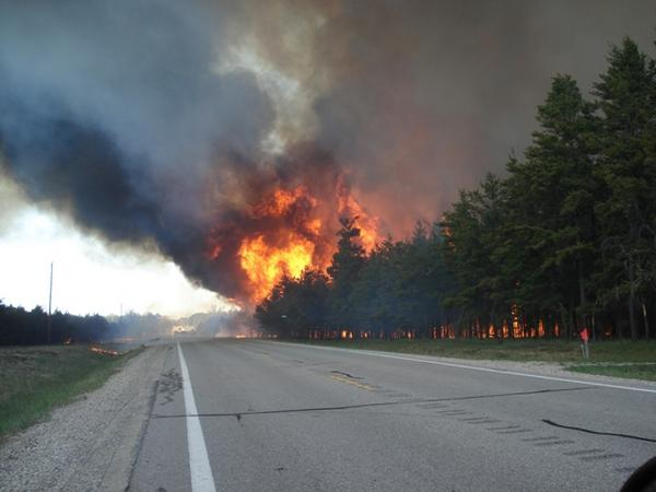 The Meridian Wildfire near Grayling, Michigan in 2010. The fire damaged and destroyed homes. It was started by one person who lost control of their burn pile.