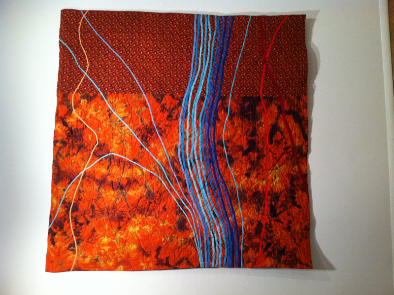 Quilt by Flint native Joe Cunningham Title: Up the Stream with Good Intentions
