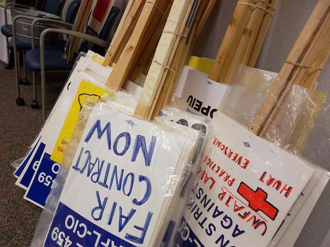 Picket signs stacked up at the south Lansing office of the Office and Professional Employees International Union hall
