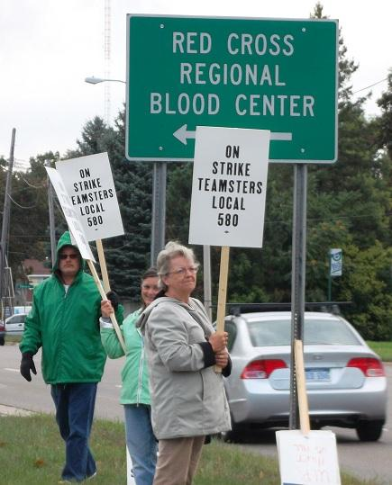 American Red Cross workers walking a picket line earlier this week in Lansing