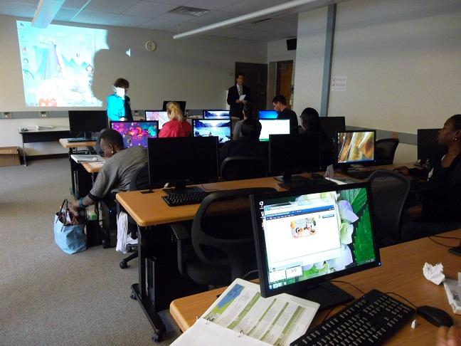 Students attending a class at ITEC's new headquarters in Lansing's Foster community center