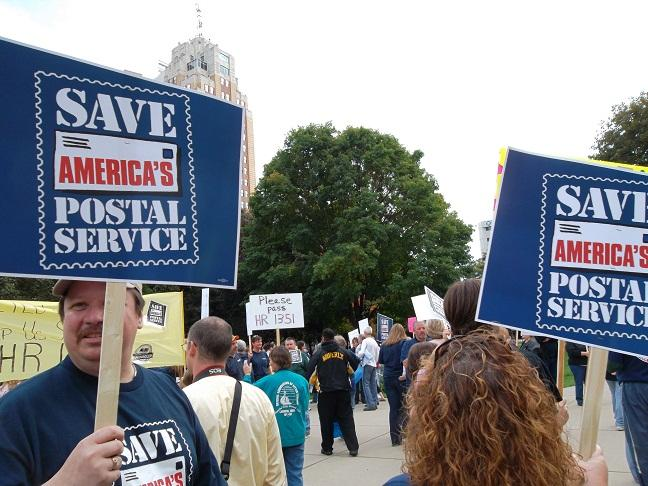 Dozens of postal workers rally in downtown Lansing