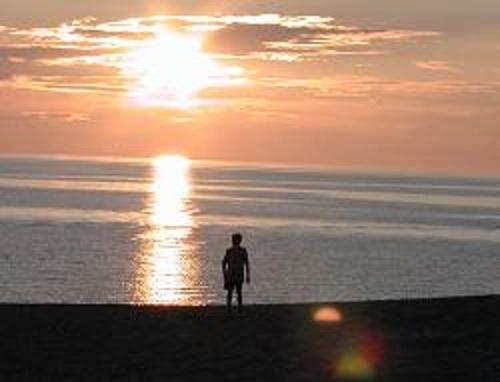 Many Michiganders don't intend to let the sun set on their summer until they've had a chance to visit the beach one last time.