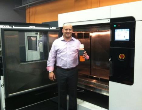 Matt Hlavin stands in front of a rapid prototyping and manufacturing machine. These can produce small batches of plastic products quickly and cheaply. This is the future, he says.