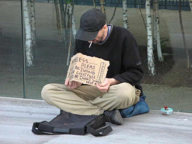 "State law bans ""begging in a public place."""