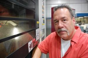 John Hill runs Midwest Mold. When his operators go home, some machines keep working.