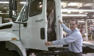 Navistar Springfield, Ohio plant manager Jim Rumpf with one of the four models of trucks now produced at the plant.