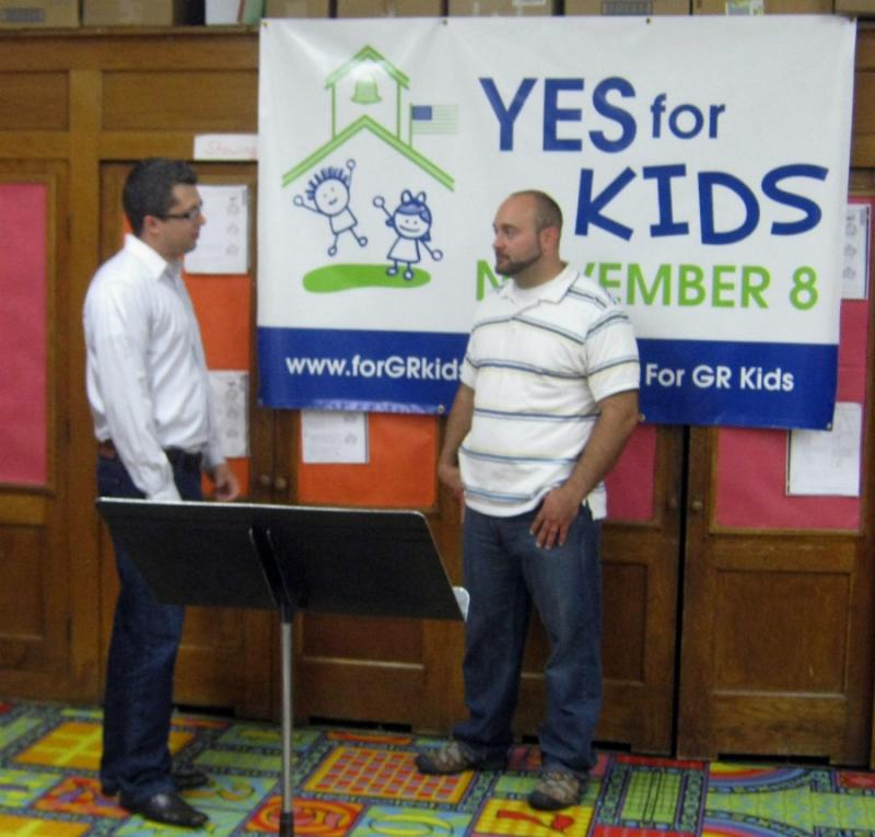 Grand Rapids School board trustee Jon O'Conor (left) and resident Michael Tuffelmire talk about the campaign following a press conference this afternoon.